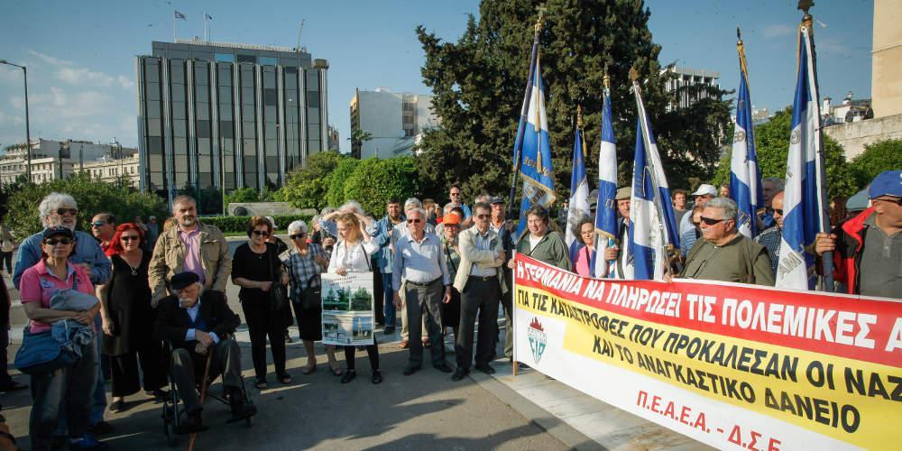 Πορεία για τις Δικαιολογημένες οι γερμανικές αποζημιώσεις από την Ελλάδα, λέει Γερμανός ιστορικόςγερμανικές αποζημιώσεις στο κέντρο της Αθήνας [εικόνες]